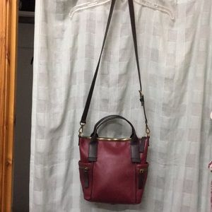 Red Fossil satchel w/ adjustable strap.
